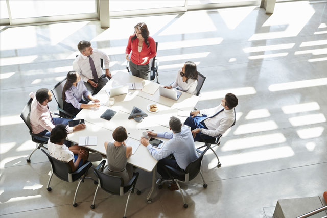 HR Board of Directors guidance around conference table leaders at Atlanta office
