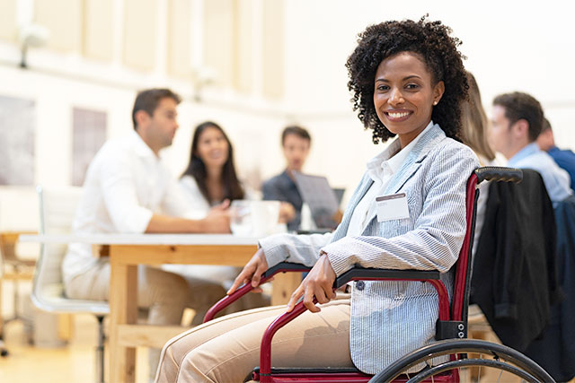 African american woman in wheelchair maintaining HR AAP and OFCCP disability compliance