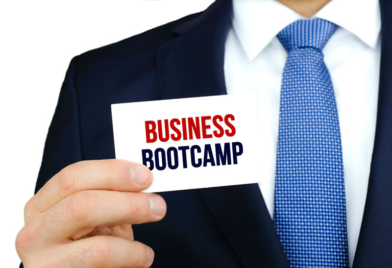 HR services agent wearing suite and tie holding business bootcamp card