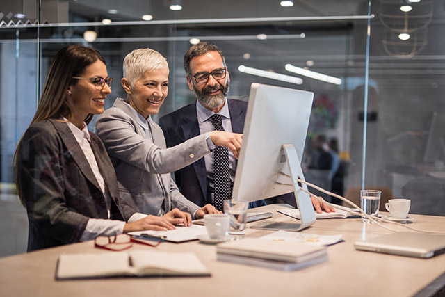 Group of employees logging into customized employee website