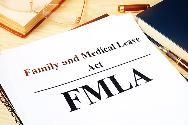 FMLA Family and Medical Leave Act pamphlet on a desk