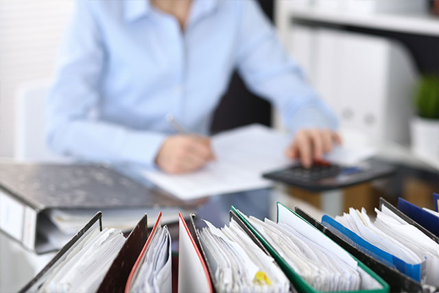 hr firm employee in Atlanta crunching numbers in records office