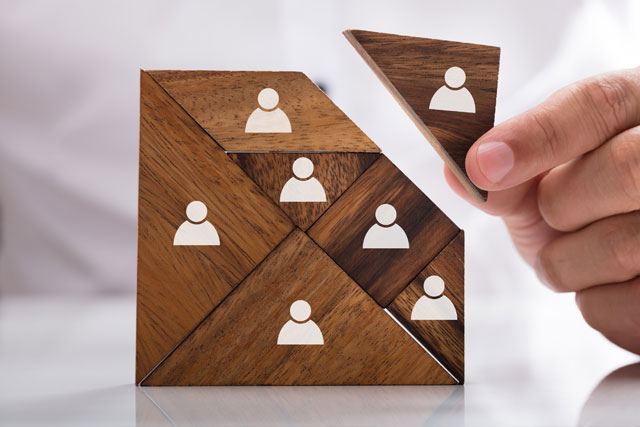 wooden puzzle showing user icons hr support