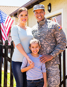 US Veteran with family in front of american flag