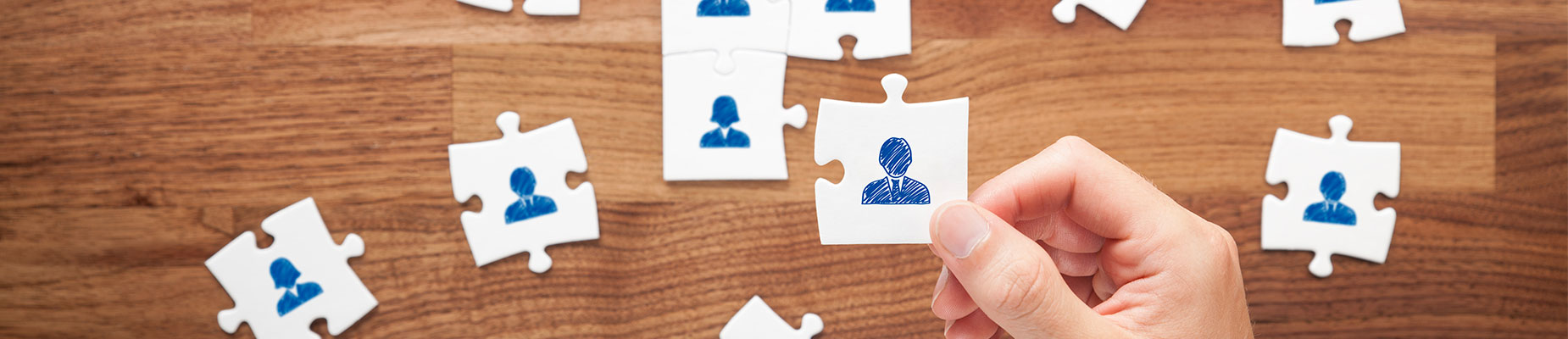 Hand with a puzzle putting together consultant career opportunities in HR
